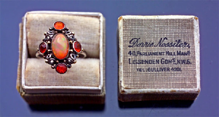 Fire Opal ring in a box showing Dorrie's business address Lissenden Gardens from 1929 - 1941, Photograph courtesy of Tadema Gallery.