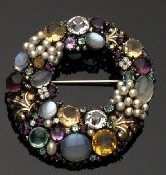 This brooch was wrongly described as being 'in the manner of Sybil Dunlop' (Tennant Auctions Ltd 2003).