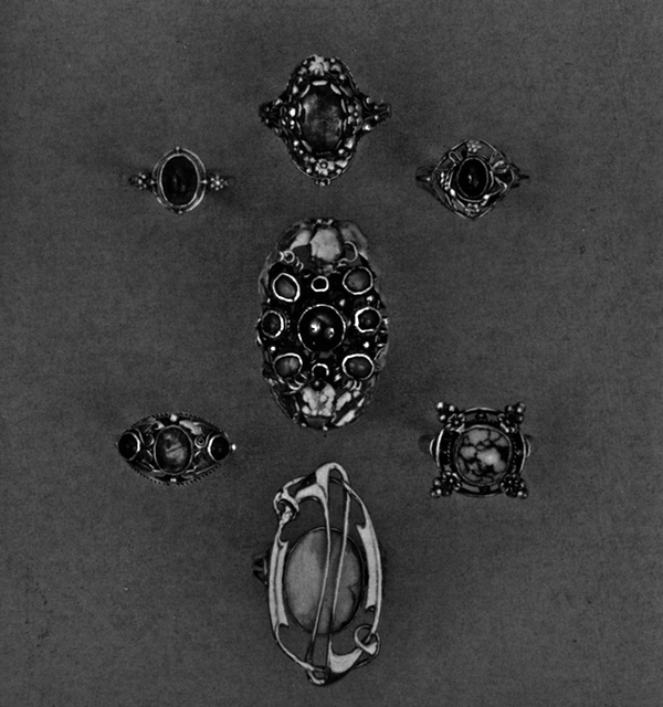 Group of rings showing the use of cabochon, semi-preciious stones, and leaf and flower clusters.